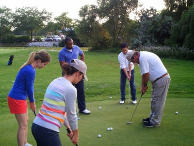 Group learning to play golf